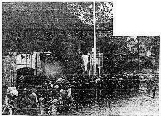 Captured troops march past ARP tunnels