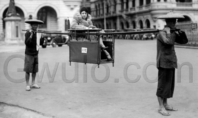 1920s Lady in sedan chair