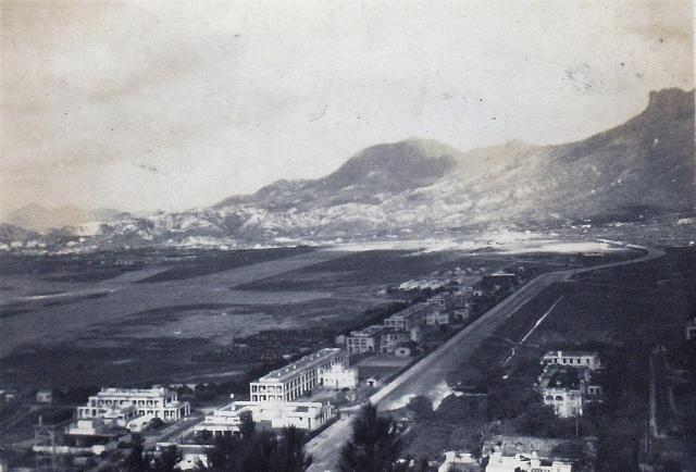 """""""View of camp with Kawloon City in the background"""""""