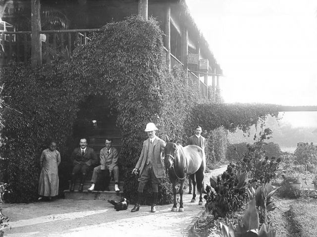 Philip Harding Klimanek visiting a friend with a race horse, Shanghai, ca. 1910