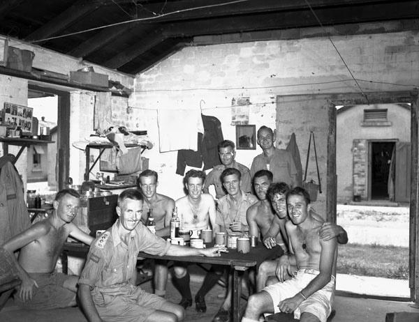 Naval personnel from the HMCS Prince Robert visiting liberated Canadian prisoners of war at Sham Shui Po Camp, Hong Kong