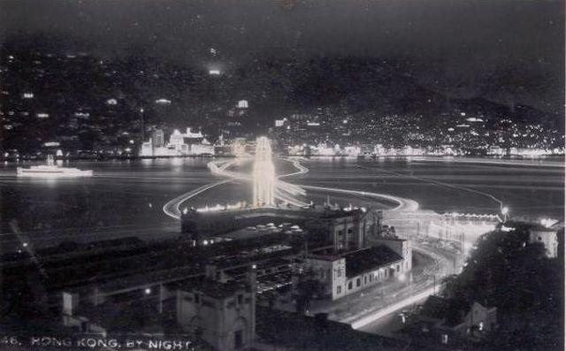 1953 Nighttime view of harbour from TST