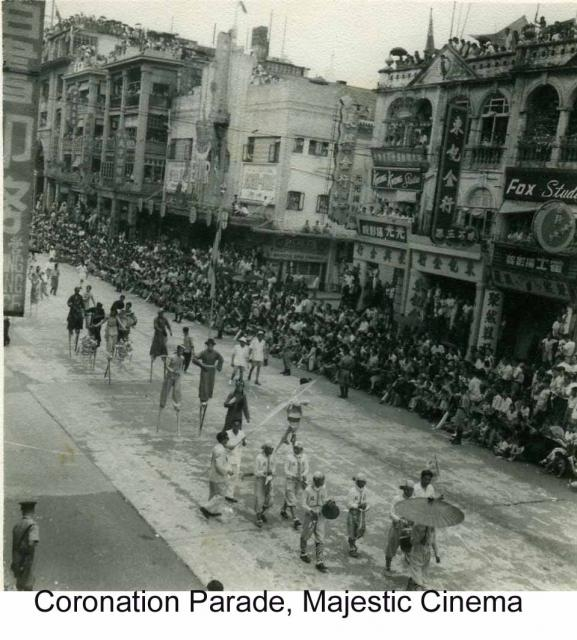 Coronation Parade 1953 on Nathan Road Stilt Walkers