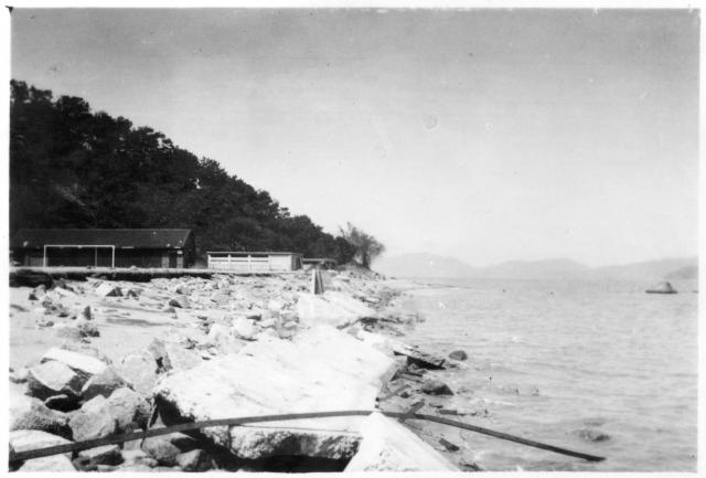 Typhoon 1936. Stonecutters sea wall,  Footy pitch strewn