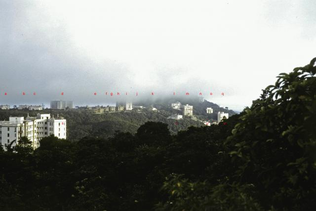 Houses on the peak in clouds