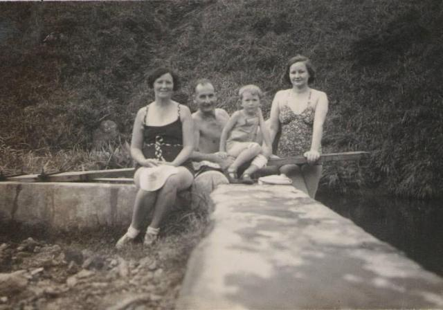 Group on the wall of the swimming pool