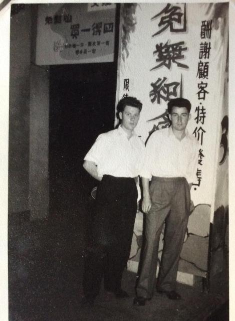 Can the location of this 1958 photo be identified by the background ?