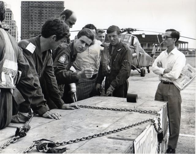(1) The pilot, Flt Lt Bob Turner, runs through the final briefing points for the lift with his crew