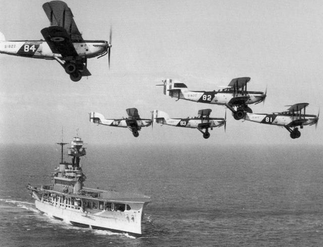 Fairey 111F-coded 81 sometime before its crash at San Tin-HK-leading its flight above HMS Eagle