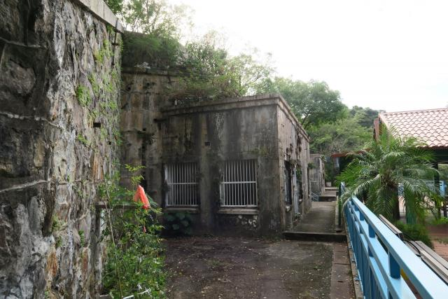 Buildings below battery - side view