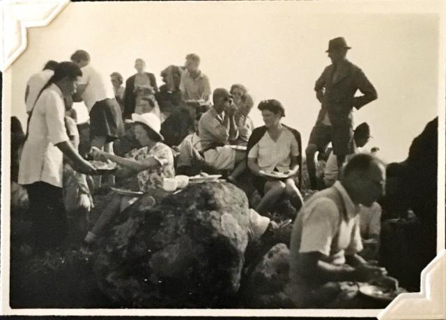 'Supper at Sunset Peak'. 24 August 1948. Includes Ann Crozier (centre right, cardigan on shoulders); Douglas Crozier (foreground right). Others unknown. Copyright Crozier family.