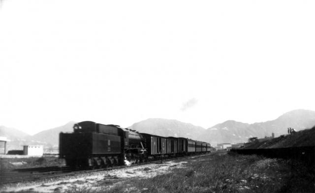 KCR Steam Locmotive No.23 leaving Kowloon with mixed local train.