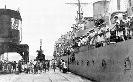 HMCS Prince Robert, next to the pier during the Hong Kong Liberation in August 1945