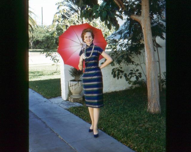 scanned mom mary K carroll nee roberts in Suzie Wong dress in hong kong island 1961.jpg