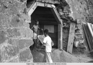 Hong Kong, men working in an air raid shelter