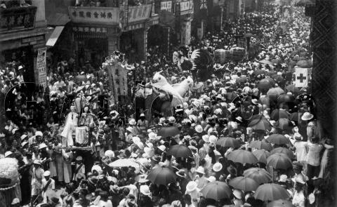 Procession inches along a crowded street