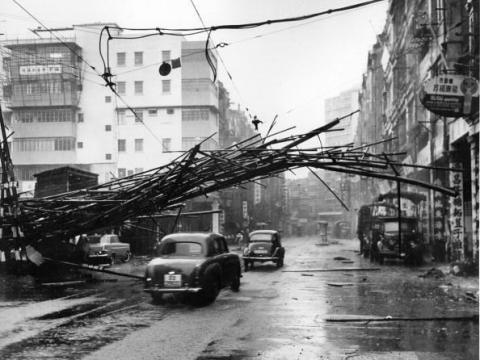1964 Scaffolding brought down by 'Typhoon Ruby' is caught by overhead tram power lines on Des Voeux Road West