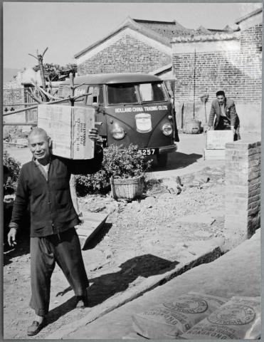 Holland-China Trading Company: portrait of porter and VW T1 delivery van, Hong Kong, ca. 1956