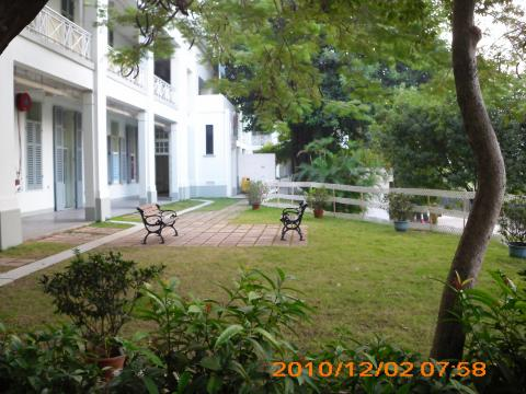 Side Lawn of The Former RAF Officers' Mess (Kai Tak) over a small hill top