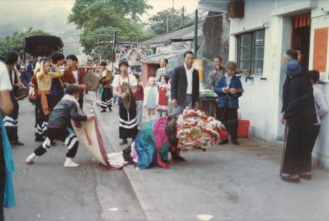 More Chinese New Year in Stanley, note village god small temple in back