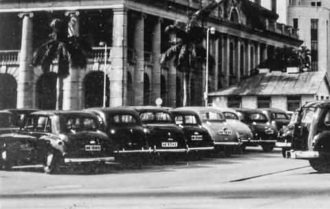 Cars parked in front of the Supreme Court, 1950s