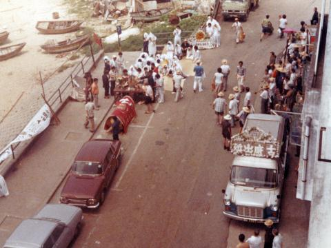 Street funeral, looking down from Sea and Sky court, Stanley Main street, squatter area in back levels-crop