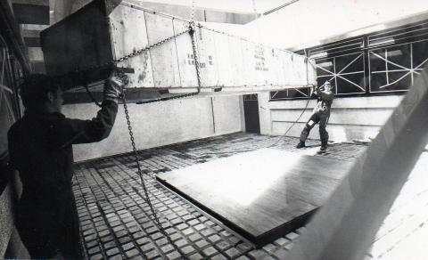 (5) Nigel Cole (nearest) and Geoff Costello position the crate as it is lowered onto the wooden base