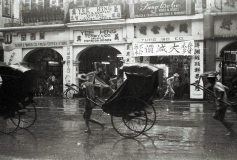 Five rickshaws in rain.