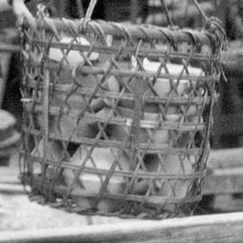 Basket of clay pots
