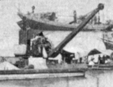 Steam crane on barge