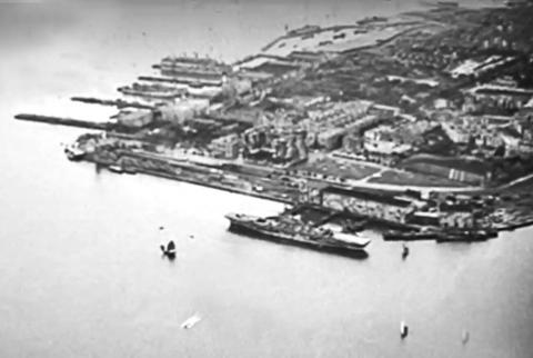 Holt's Wharf-liberation aircraft carrier moored-1945