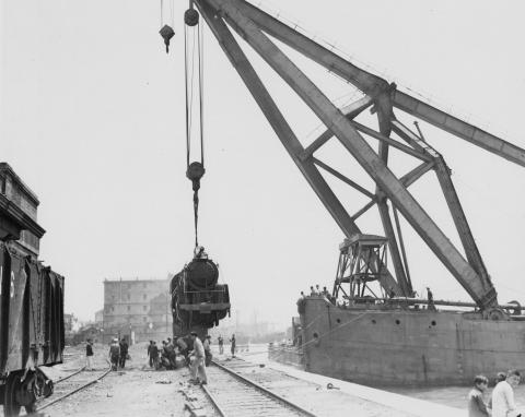 Lowering a locomotive on the tracks at KCR Terminus March 1947