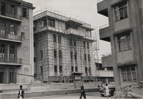 Four-story building under construction, designed by V. N. Dronnikoff