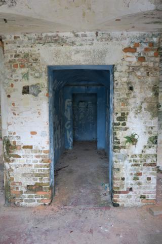 Looking in through bars - passageway leads into distance