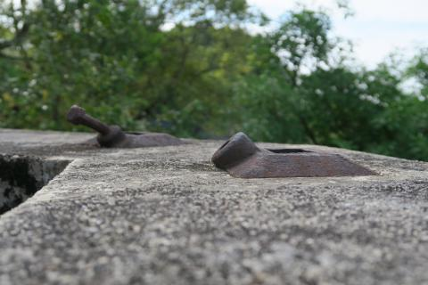 Iron mountings on top of emplacement wall