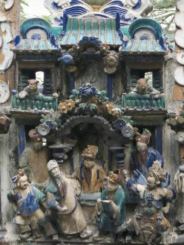 Close-up of the characters on the roof