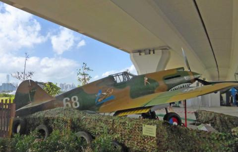 Curtis P40 fighter replica under flyover at Kwun Tong