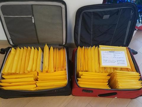 Books ready for a trip to the Post Office