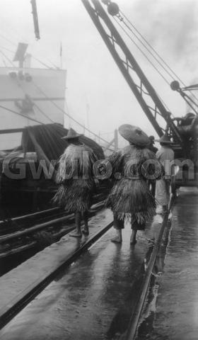 "1927 - ""Coolies wearing Chinese raincoats"""