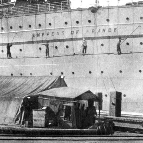 RMS Empress of France getting a fresh coat of paint at the Kowloon Wharves