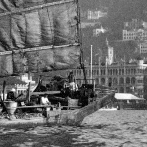 c.1929 Junk in Hong Kong's harbour with Queen's Building in the background