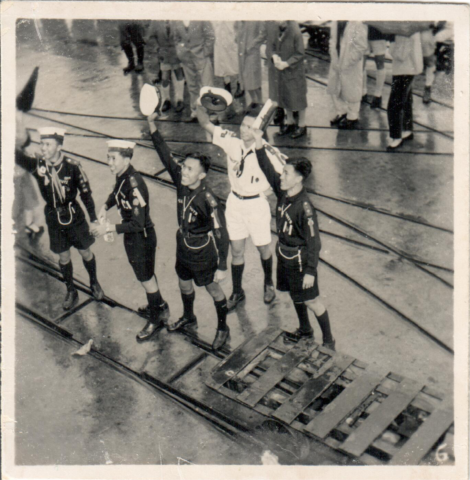 Scouts waving goodbye from dock, location unknown, c1952/53