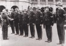 Sir Geoffry Northcote presenting medals to police officers at the Central Police Station
