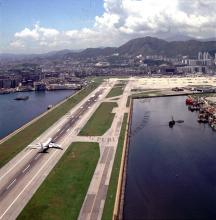 1990 The single runway at Kai Tak International Airport, seen from the east
