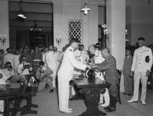 Maj.-Gen. Okada handing over his sword during the ceremony marking the surrender of Japan in Hong Kong, Government House