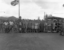 Canadian and British prisoners of war awaiting liberation by the landing party from HMCS Prince Robert, Hong Kong