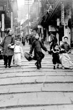 Chinese lady with children on corner of Pottinger Street