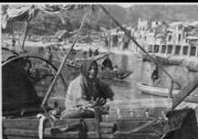 Woman seated in a boat - Stanley, Hong Kong harbor - 1947