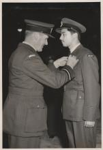 G C Randall receives wings