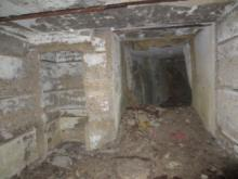 Looking back down the corridor from the basement